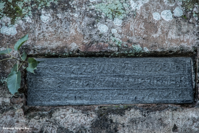 Old writings carved on a stone on the walls of Janardhan Temple.